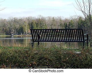 riverside bench - bench along the mille isles river in...