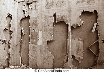 Derelict - The broken walls of a derelict building in...