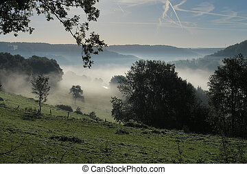 Valley Fog - Hills and valleys in the Palatinate area of...