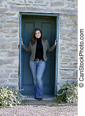 Outdoor Fashion - Young Woman Standing In An Old Doorway
