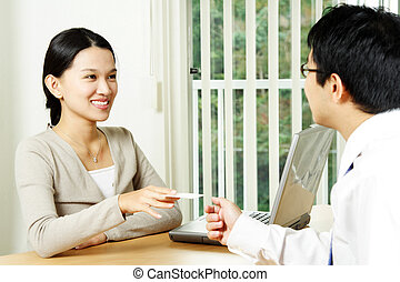 Businesswoman - A businesswoman handing out a business card...