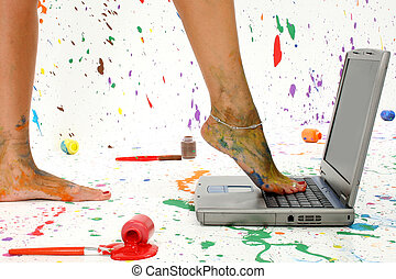 Paint Splash - Womans foot on laptop Surounded by splattered...
