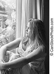 sitting alone - A teenage girl sitting alone on a rainey...