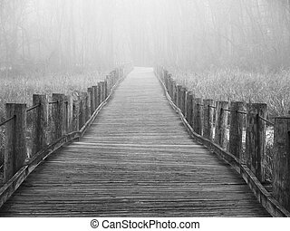 Lost in the fog - A mysterious image of a wooden footbridge...