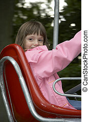 young girl on the playground-lift