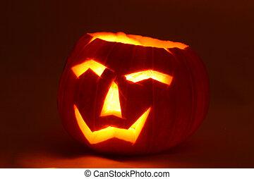 halloween pumpkin - cutout face in a pumpkin lit for...