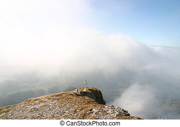 peak of a high mountain over the clouds