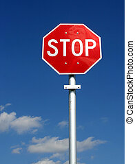 Stop Sign - Red and white US style stop sigh shot against a...