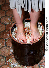 Preparing sauerkraft - Little girl trampling shredded...