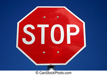 Stop Sign - Red and white U.S. style stop sigh shot against...