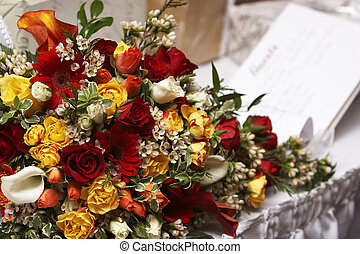 Brides bouquet with a guest book in the background - A...