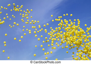 Yellow balloons on a blue sky background