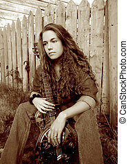 Songwriter sepia - A beautiful country singer with a dobro...