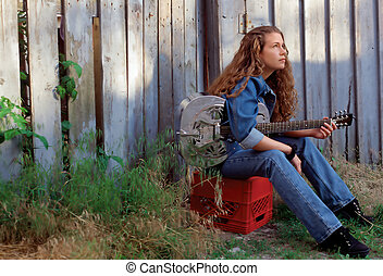 Songwriter - A beautiful country singer thinking about her...