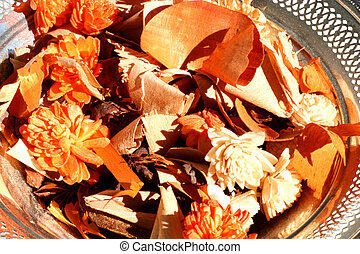 PotPourri - Silver bowl containing orange and brown pot...
