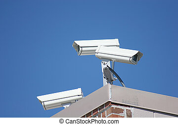 Security Cameras 2 - Three security cameras on top of...