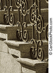 Wrought iron railing - A sepia image of wrought iron...