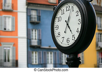 Swiss time - Street clock at five pm, in Locarno Switzerland...