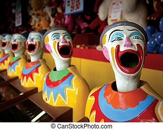 Mouthy clowns - A row of clowns at an amusement park game.