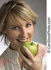 apple - young woman eating green apple