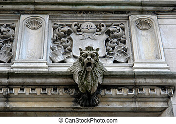 Detail elaborate mansion with coat of arms - detail of...