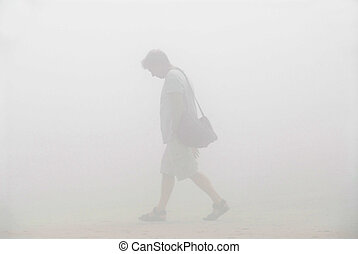 Man walking in a fog - Man trying to fing his way in a thick...