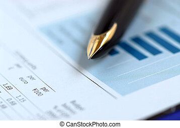 Pen finance chart - Golden fountain pen on financial chart