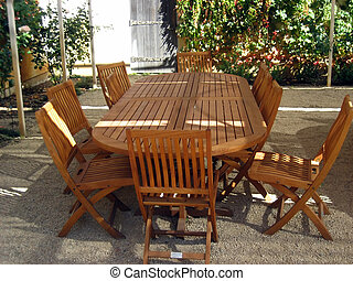Eating Outside - teak table and chairs set up on the patio...
