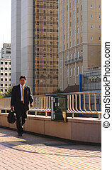 Business world 3 - Businessman walking in a financial...