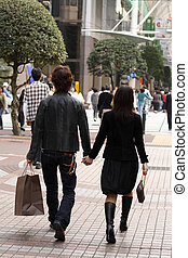 Young couple shopping - Young couple walking in a urban...