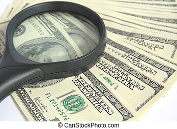 Magnifying Glass and Money - Magnifying glass over hundred...