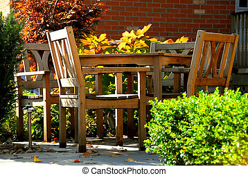Patio - House patio with natural wooden patio furniture