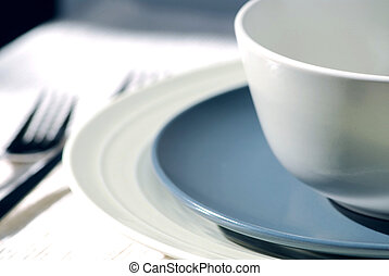 Place setting - Dinner place setting with plates and soup...