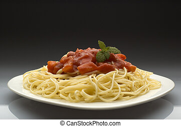 pasta - spghetti with tomato grawy on a plate