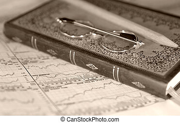 Accounting - Photo of a Ledger Bood, Pencil, Eyeglasses and...
