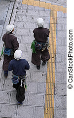 Workers walking in the street-upper view