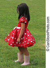Red and White Polka Dot Dress - Little girl in a red and...