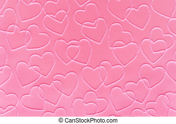 Pink Hearts - Pastel pink linked hearts embossed on paper.