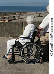 Elderly Woman in a Wheelchair - Elderly woman in a...