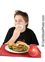 eating tacos - boy wipes his mouth while enjoying his taco...