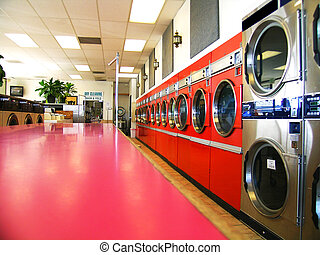 Retro Laundry - Laundromat row of commercial clothes dryers,...
