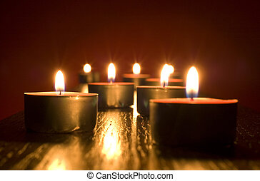 candles - group of small candles on red background