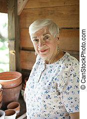 The Constant Gardener - A sweet senior lady gardening in her...