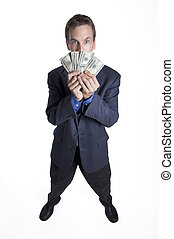 Greed is good - Businessman holding money up to his face
