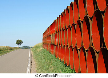 Pipe Symmetry Red - Pipes for a new gas pipeline wait on a...