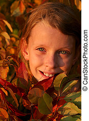 Autumnal portrait - Portrait of a young girl with colorful...