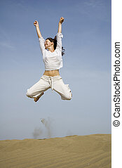 happy holidays4 - girl jumping for joy from the dunes in...