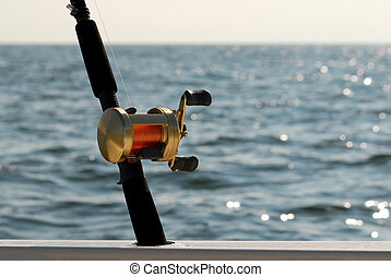 fishing rod and casting reel - Secured in a boat rod holder...