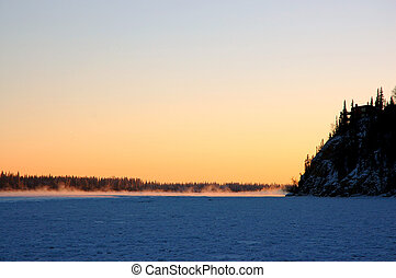 Frozen Sunset - The sun sets over the frozen Chena River,...