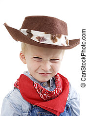 Expressive little boy - Happy young boy with a cowboy hat...